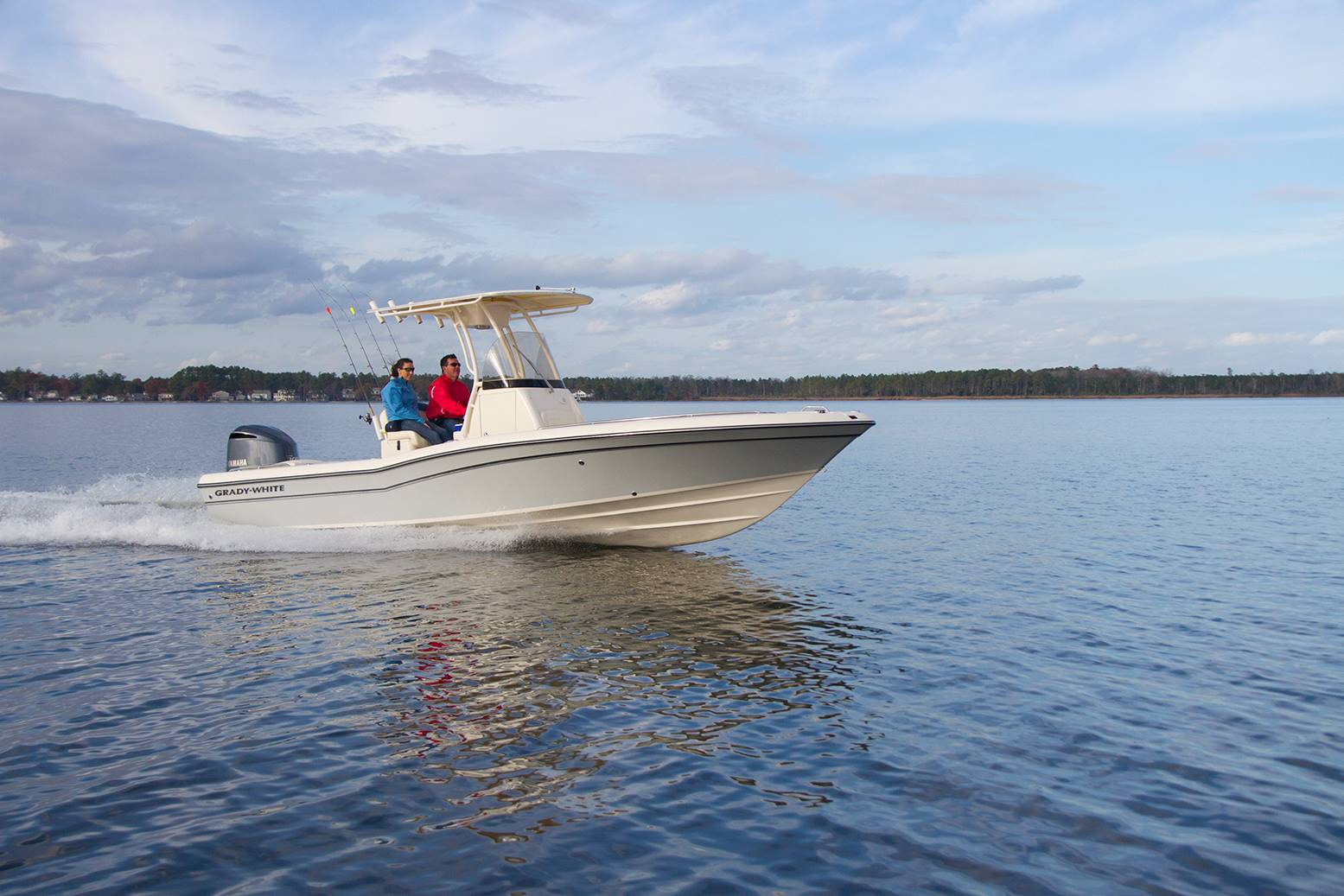 A center console Grady-White heads out for a day of fishing with two people aboard.