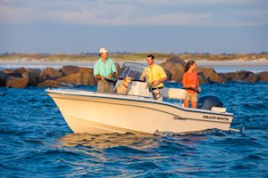 Grady-White Fisherman 180 18-foot center console friends fishing by jetty with dog