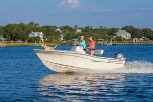 Grady-White Fisherman 180 18-foot center console running family with dog
