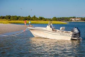 Grady-White Fisherman 180 18-foot center console at anchor at sandbar couple on beach