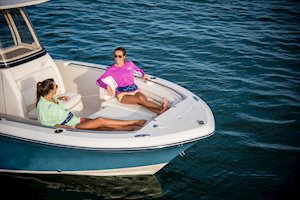Grady-White Fisherman 216 21-foot center console cushioned bow seating with forward facing foldaway bolstered backrest