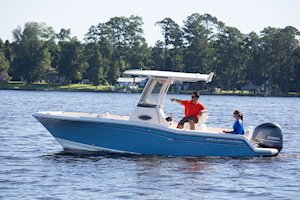 Grady-White Fisherman 216 21-foot center console port side couple cruising guy pointing