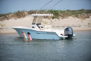 Grady-White Fisherman 236 23-foot center console family in water by beach