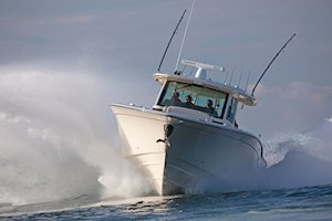 Grady-White Canyon 456 45-foot center console fishing boat running carving a turn