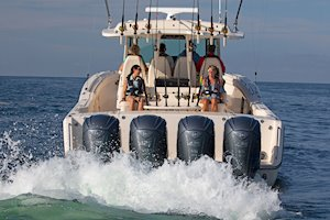 Grady-White Canyon 456 45-foot center console fishing boat running view of stern