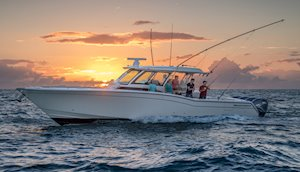 Grady-White Canyon 456 45-foot center console fishing boat running at sunset