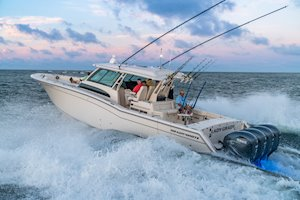 Grady-White Canyon 456 45-foot center console fishing boat running at sunrise