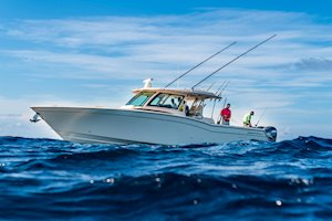 Grady-White Canyon 456 45-foot center console fishing offshore in blue water
