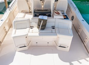 Grady-White Canyon 456 45-foot center console fishing boat aft facing sea command seating