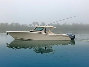Grady-White Canyon 456 45-foot center console fishing boat running on misty calm water