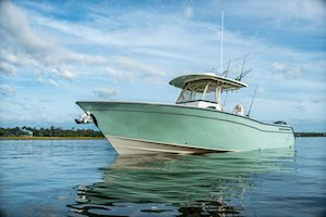Grady-White Canyon 306 30-foot center console boat profile sea glass color hull