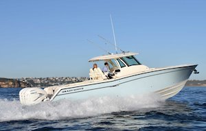 Grady-White Canyon 376 37-foot center console boat running starboard side city