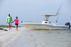 Grady-White 251 CE 25-foot Coastal Explorer fishing boat couple walking on beach