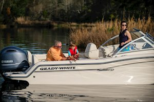 Grady-White Freedom 215 21-foot dual console kid reeling in fish