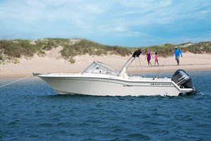 Grady-White Freedom 235 23-foot dual console at anchor family on beach