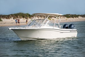 Grady-White Freedom 255 25-foot dual console boat port side with family on beach
