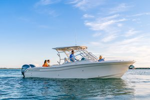 Grady-White Freedom 275 27-foot dual console family on boat starboard side