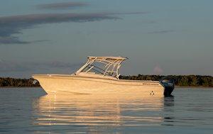 Grady-White Freedom 275 27-foot dual console boat port side sunrise
