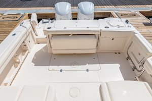 Grady-White Freedom 325 32-foot dual console fishing boat cockpit with fold-away aft bench seat and transom door