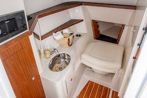 Grady-White Freedom 325 32-foot dual console fishing boat port console head area