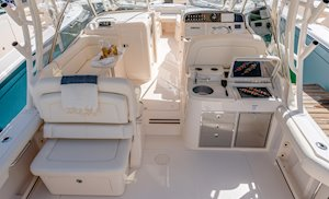 Grady-White Freedom 335 33-foot dual console fishing boat cockpit seating and wet bar with grill