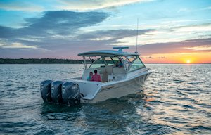Grady-White Freedom 375 37-foot dual console fishing boat cruising at sunset
