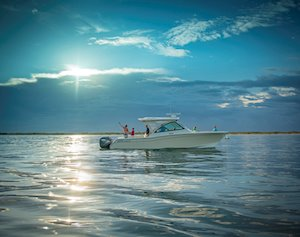 Grady-White Freedom 375 37-foot dual console fishing boat fishing at sunrise