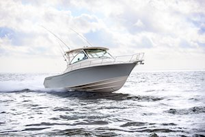 Grady-White Boats Express 370 37-foot Express Cabin boat running starboard