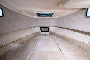 Grady-White Boats Adventure 208 20-foot Walkaround Cabin fishing boat cabin interior berth with cushions