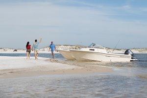 Grady-White Boats Adventure 208 20-foot Walkaround Cabin fishing boat exploring beach