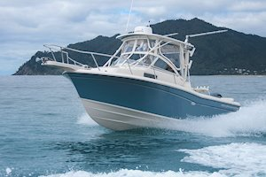 Grady-White Boats Adventure 208 20-foot Walkaround Cabin fishing boat running bow on