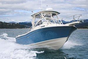 Grady-White Boats Adventure 208 20-foot Walkaround Cabin fishing boat running with canvas closeup
