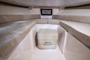 Grady-White Boats Adventure 208 20-foot Walkaround Cabin fishing boat cabin interior with portable head