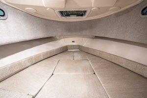Grady-White Canyon 228 22-foot walkaround cabin fishing boat cabin interior forward with cushions