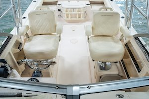 Grady-White Canyon 228 22-foot walkaround cabin fishing boat deluxe helm and companion chairs