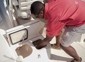 Grady-White Canyon 228 22-foot walkaround cabin fishing boat divided port-side fish box
