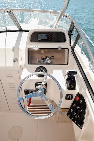 Grady-White Canyon 228 22-foot walkaround cabin fishing boat helm with lockable electronics box