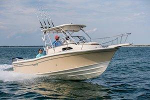 Grady-White Canyon 228 22-foot walkaround cabin fishing boat running starboard side