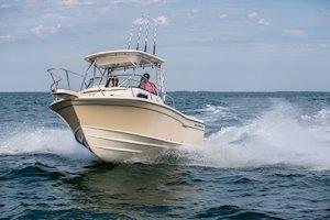 Grady-White Canyon 228 22-foot walkaround cabin fishing boat running bow on