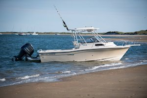 Grady-White Canyon 228 22-foot walkaround cabin fishing boat at beach