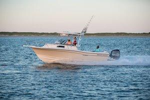 Grady-White Canyon 228 22-foot walkaround cabin fishing boat running port side
