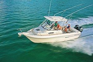 Grady-White Freedom 232 23-foot walkaround cabin fishing boat running port side