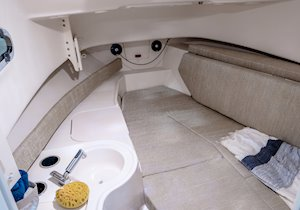 Grady-White Freedom 232 23-foot walkaround cabin fishing boat cabin interior with berth