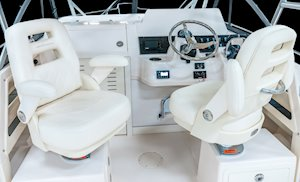 Grady-White Freedom 232 23-foot walkaround cabin fishing boat deluxe helm and companion chairs