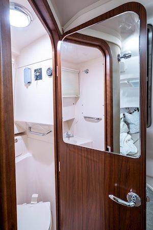 Grady-White Marlin 300 30-foot walkaround cabin boat interior head door with mirror