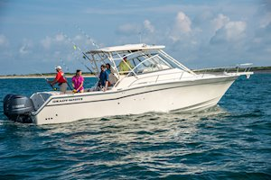 Grady-White Boats Express 330 33-foot Express Cabin Boat fishing inshore starboard side