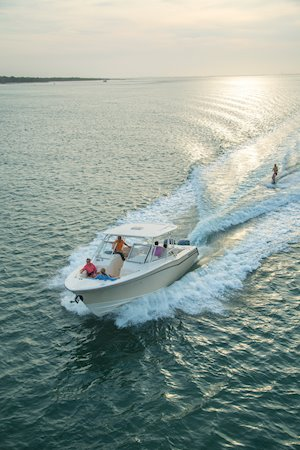 Grady-White Freedom 307 30-foot dual console running with skier