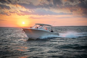 Grady-White Freedom 307 30-foot dual console running sunset bow forward