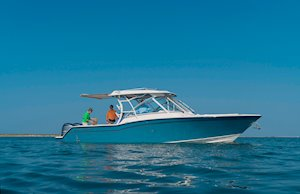 Grady-White Freedom 325 32-foot dual console fishing boat with sureshade