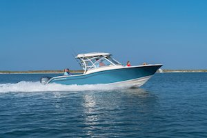 Grady-White Freedom 325 32-foot dual console fishing boat running starboard side